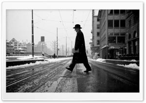 A Man Crossing The Street