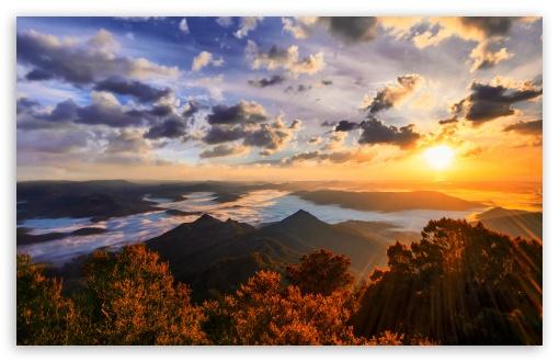 Download Sun Shining Over Mountains UltraHD Wallpaper