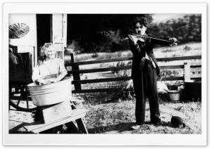 Charlie Chaplin Playing Violin