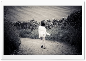 Girl Walking On Country Road