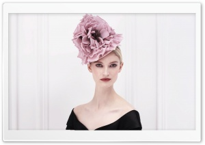 Woman Wearing a Fancy Fascinator
