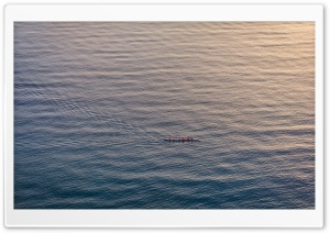 People Rowing a Boat