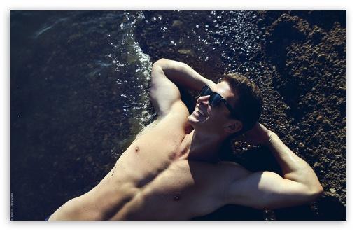 Download Man Sunbathing On Beach UltraHD Wallpaper