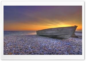 Boat On Pebbles Beach
