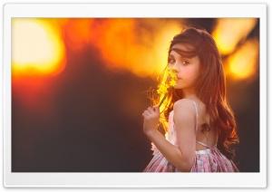 Cute Girl Smelling a Flower